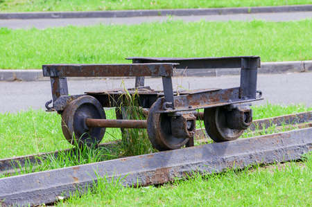 very old cart on rails for transporting ore. High quality photo