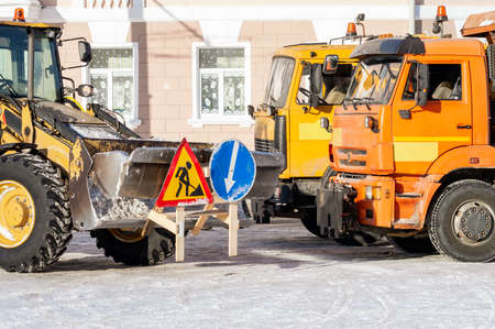 road repair signs on the bucket of the tractor. High quality photo