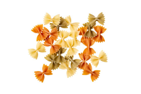Color pasta in the form of bows. Raw farfalle with spinach and tomato isolated on a white background. High quality photo