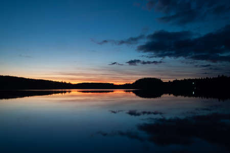 beautiful evening landscape with sky reflected in the water. High quality photo
