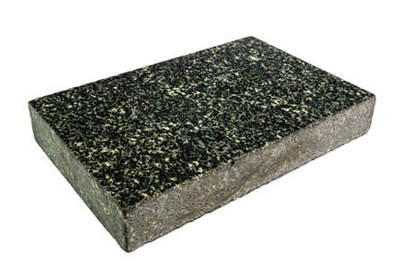 piece of polished granite in the form of a paralepiped isolated on a white background Фото со стока