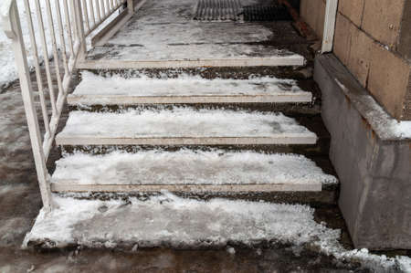 steps covered with ice and snow. Dangerous staircase. High quality photo