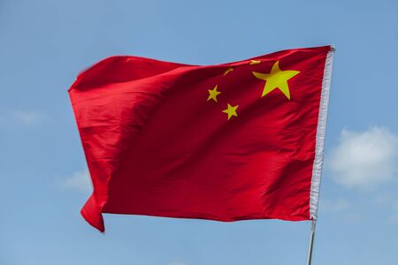 Windswept flag of the people`s Republic of China 版權商用圖片 - 150103045