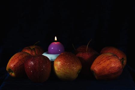 Red apples on black background