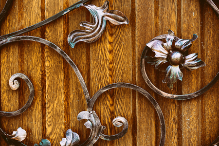 Details, structure and ornaments of wrought iron fence with gate close-up Archivio Fotografico