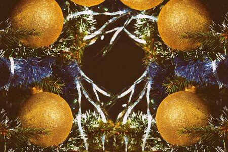 Christmas tree background.Christmas pattern with golden balls on the New Year tree Banco de Imagens