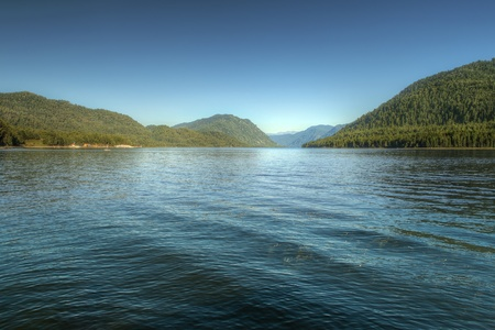 altay: Teletsky mountain lake in Altay (Russia) with clear blue summer sky