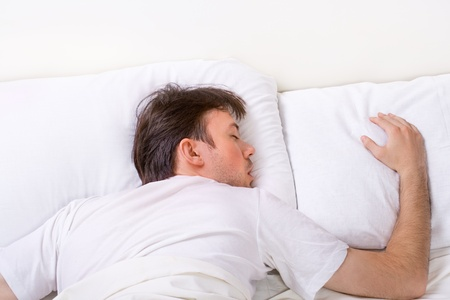 Man sleeps on bed with very deep sleep