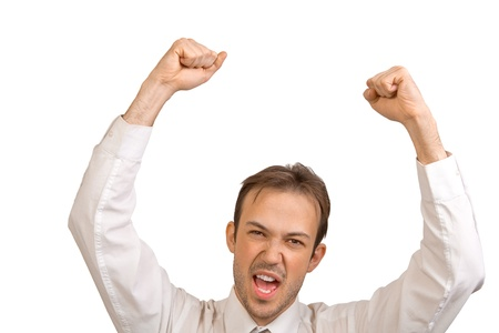 Businessman in white shirt rejoices in victory photo