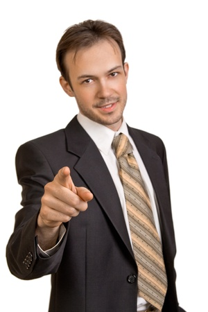 Smiling young businessman  points to camera on white background photo