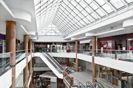 Interior of modern mall with some people in it