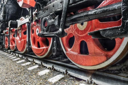 novosibirsk: The details of drive mechanism and red wheels of an old soviet steam locomotive Stock Photo