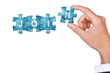 Join us now - hand connects puzzle piece with letter to build word join photo