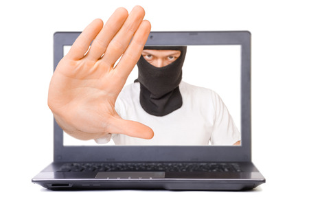 Man in black mask on display - computer security concept photo