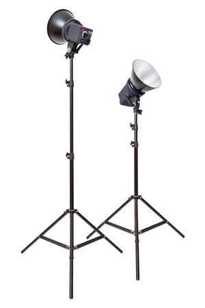 Two studio flash light monoblocks on tripods isolated on white background photo