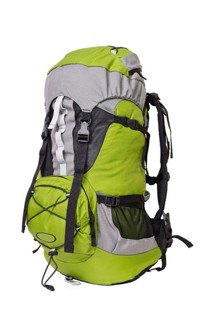 Side shot of green touristic backpack on white background