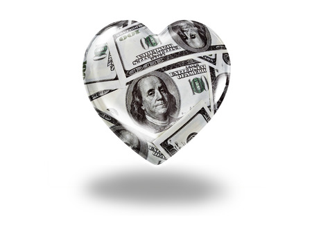 Heart with 100 dollar bills - paying for love concept photo