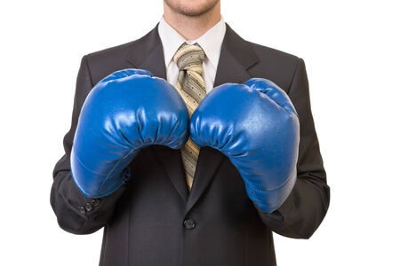 Businessman in black suit with boxing gloves - isolated on white background photo