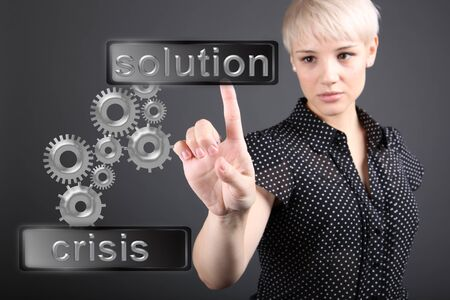 Crisis solving concept - business woman touching screen photo