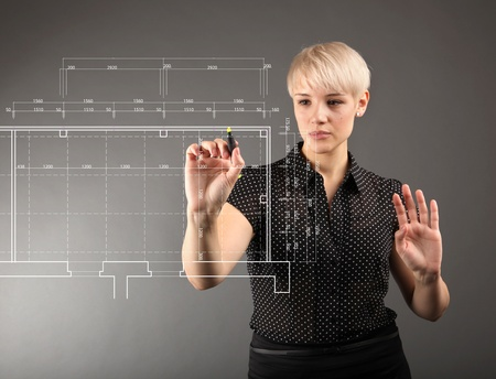 interior drawing: Blueprint design technical concept - girl drawing on screen Stock Photo