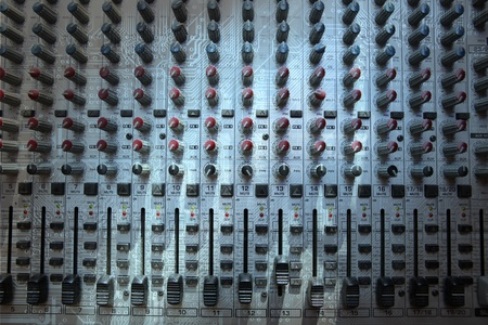 Audio mixing console closeup - music concept, studio shot photo
