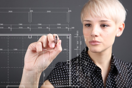 Hand and blueprint - engineer working on blue print concept photo
