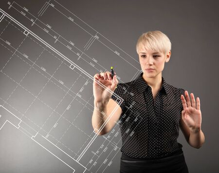 Blueprint design technical concept - girl drawing on screen Stock Photo - 13173485
