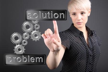 問題解決の概念 - ビジネスの女性が画面に触れる 写真素材