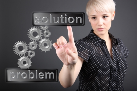 Problem solving concept - business woman touching screen photo