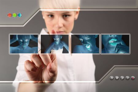 Girl choosing photo from touch screen - modern photography concept Stock Photo - 13888681