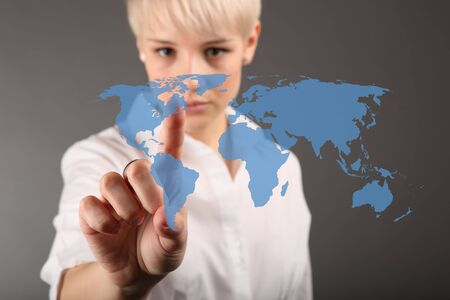 World business connection concept - business woman touching screen photo