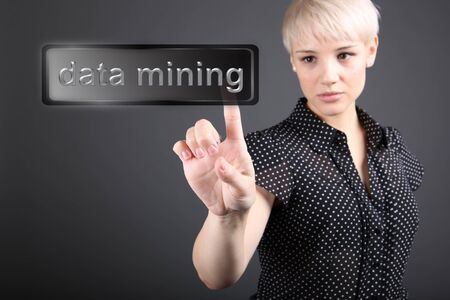 Data mining concept - business woman touching screen photo
