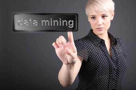 Data mining concept - business woman touching screen
