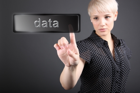 Data concept - business woman touching screen photo