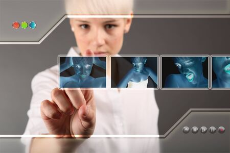 Girl choosing photo from touch screen - modern photography concept photo