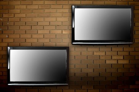 Plasma TVs on the wall photo