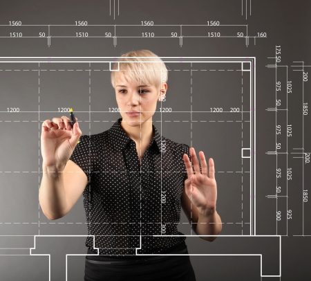 architectural: Blueprint design technical concept - girl drawing on screen Stock Photo