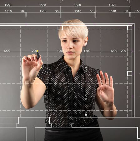 Blueprint design technical concept - girl drawing on screen photo