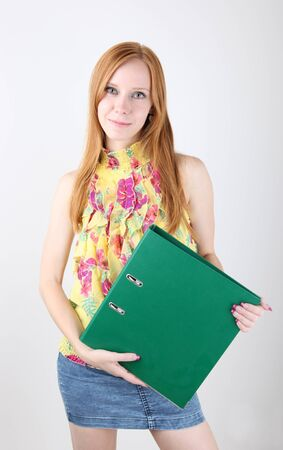 Businesswoman Holding a Binder photo