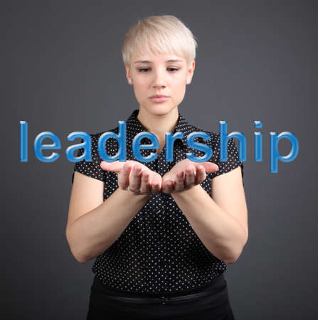 Leadership business concept - woman with word photo