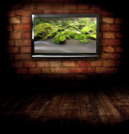 Plasma TV on the wall with possitive picture Stock Photo
