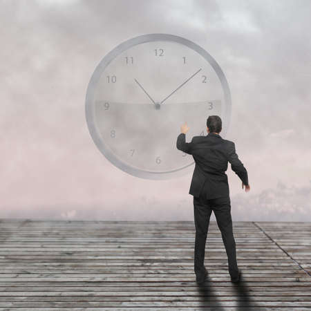 Businessman standing - time strategy concept incolor photo
