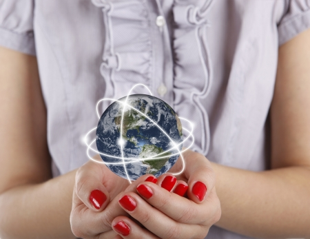 Business woman holds Earth in hands photo