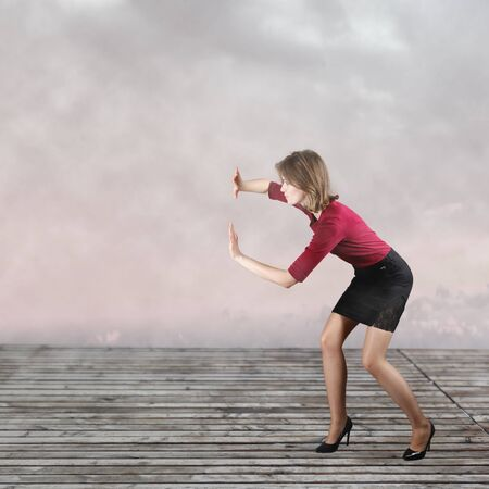 Business woman pushing something imaginary photo
