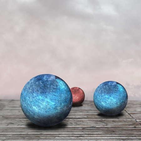 Textured spheres lying on the wooden floor photo