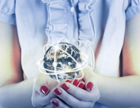 Business woman holds Earth in hands Stok Fotoğraf
