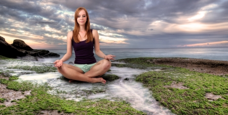 Girl meditating at the calm place Stock Photo - 25448533