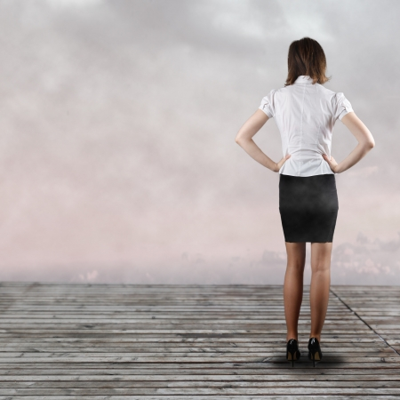 Young business woman standing backside - presentation concept photo