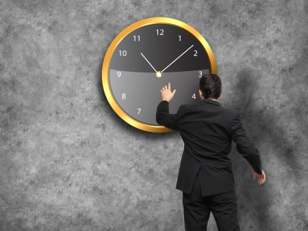 Businessman standing - time strategy concept in color photo