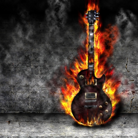 music instruments: The burning guitar in the old room Stock Photo